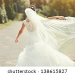 happy bride spinning around... | Shutterstock . vector #138615827