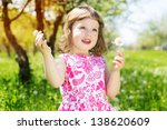 child girl at dandelion meadow in summer - stock photo