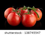 Red Tomatoes On A Black...