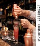 bartender is straining cocktail ... | Shutterstock . vector #138886127