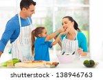 loving little daughter feeding...   Shutterstock . vector #138946763