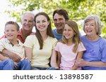 extended family sitting... | Shutterstock . vector #13898587