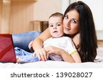 mother and son are using laptop ... | Shutterstock . vector #139028027