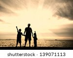 silhouette of happy family at...   Shutterstock . vector #139071113