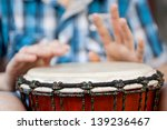 Young Man Playing On Djembe....