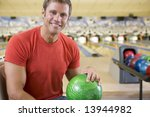 young man holding a bowling... | Shutterstock . vector #13944982