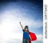 Superhero Kid Against Dramatic...