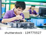 one chinese worker assembling... | Shutterstock . vector #139775527