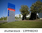 Modern Hospital And Sign With...