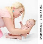 young mother with her newborn... | Shutterstock . vector #140155453