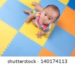 baby playing with colorful... | Shutterstock . vector #140174113