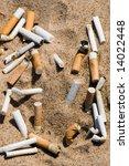Cigarette Butt In Sand. Litter...