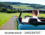 rear view shot of man driving a ... | Shutterstock . vector #140234707