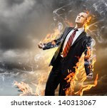 Small photo of Image of young businessman in anger burning in fire