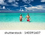 couple on a tropical beach at... | Shutterstock . vector #140391607