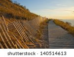 Boardwalk And Fence On Sandy...