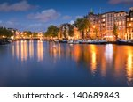 Stock photo pretty starry night time illuminations of dutch doll houses reflected in the tranquil canals of 140689843