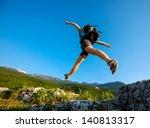 hiker jumps over the rock | Shutterstock . vector #140813317