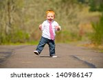 a one year old boy taking some... | Shutterstock . vector #140986147