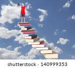 teen on top of book stair case... | Shutterstock . vector #140999353