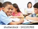 pupils studying at desks in... | Shutterstock . vector #141101983