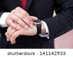 groom with the clock on the hand | Shutterstock . vector #141142933