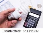 light bulb whit calculator and... | Shutterstock . vector #141144247
