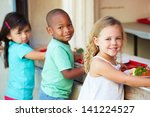 elementary pupils collecting... | Shutterstock . vector #141224527