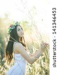 pretty girl in a spring  flower ... | Shutterstock . vector #141346453