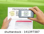hands scanning qr code from... | Shutterstock . vector #141397387
