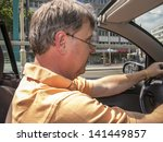 man driving his cabrio at a... | Shutterstock . vector #141449857
