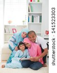 malay family using tablet... | Shutterstock . vector #141523303