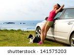 happy woman and dog enjoying... | Shutterstock . vector #141575203