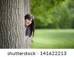 Beautiful Young Woman Hiding...