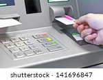 Hand Inserting Atm Credit Card...