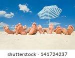 Human Feet On The Sand  Beach