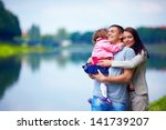 happy family portrait  outdoors   Shutterstock . vector #141739207