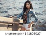 asian woman outdoors | Shutterstock . vector #141805027