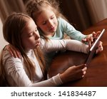 children playing on tablet.... | Shutterstock . vector #141834487