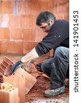 mason smashing brick | Shutterstock . vector #141901453