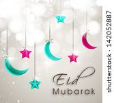 Eid Mubarak background with colorful hanging moon and star on abstract background.