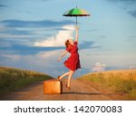 redhead girl with umbrella and...