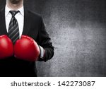businessman in boxing gloves on ... | Shutterstock . vector #142273087
