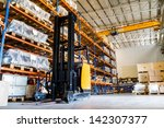modern warehouse with forklifts | Shutterstock . vector #142307377