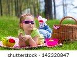 little girl eating grapes at... | Shutterstock . vector #142320847