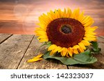 Sunflower And Wooden Table