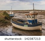 old wooden fishing boat on mud...   Shutterstock . vector #142387213