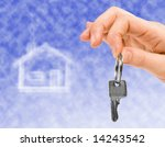 hand holding key of a property... | Shutterstock . vector #14243542