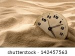 old face of clock in sand | Shutterstock . vector #142457563