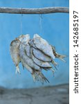 pack of fish hanged to dry with ... | Shutterstock . vector #142685197